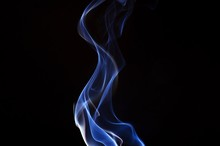 Close-Up Of Blue Smoke Against...