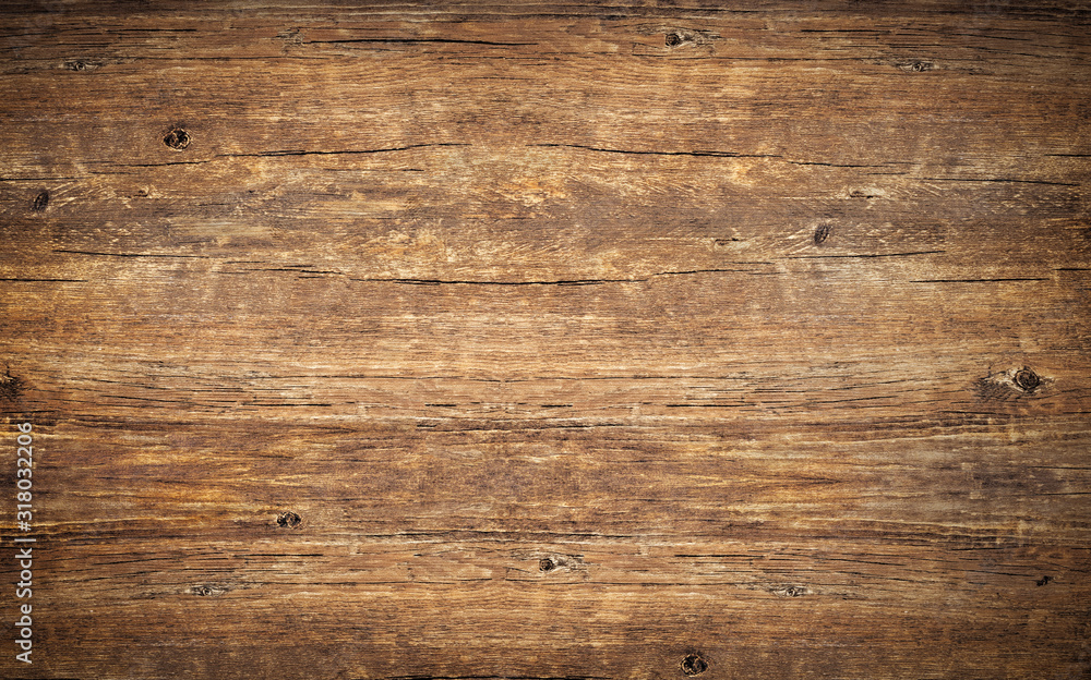 Fototapeta Wood texture background., rough rustic knotted table with cracks, brown vintage surface of old wooden board with nature color and pattern. Dark barn material.