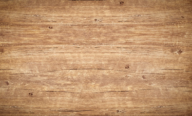 Wood texture background. Top view of vintage wooden table with cracks. Light brown surface of old knotted wood with natural color, texture and pattern.