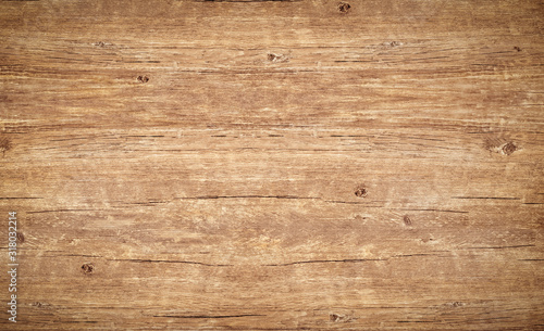 Wood texture background. Top view of vintage wooden table with cracks. Light brown surface of old knotted wood with natural color, texture and pattern. - 318032214