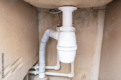 Vászonkép Hydraulic siphon pipes and water drain under the washing basin, bowl in bathroom