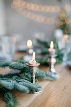Close-Up Of Lit Candles On Table Christmas Decorations On Table