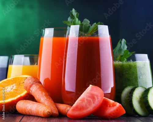 Fototapeta Glasses with fresh organic vegetable and fruit juices obraz