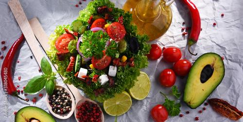 Fototapeta Composition with vegetable salad bowl