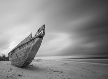 An Abandoned Boat In Ilashe Be...