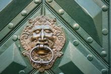 Door Knocker On A Old Door.