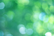 Leinwandbild Motiv  Abstract bokeh, natural green and blue background, beautifully blurred during the summer, which is a blue-green bokeh taken from the leaves on the tree and has a yellow-blue light