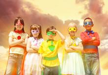Cute Little Children Dressed As Superhero Against Sky