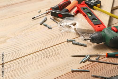 Fotografie, Tablou Set of tools for furniture assembling on wooden background