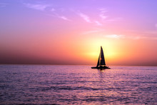 A Sailboat In Front Of A Sunset