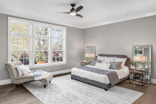 Beautiful Bedroom In New Luxury Home With Large Windows And Area Rug
