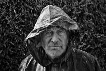 Portrait Of Man Wearing Rainco...