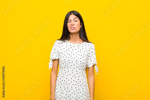 young pretty latin woman looking goofy and funny with a silly cross-eyed express Wallpaper Mural