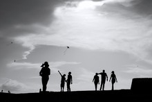 Silhouette People Standing Against Sky
