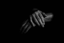 Close-Up Of Human Hands Over B...