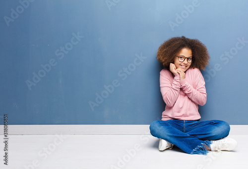 african american little girl feeling in love and looking cute, adorable and happ Wallpaper Mural
