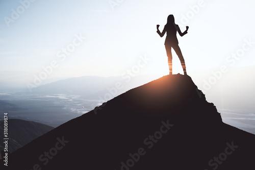 Happy businesswoman on cliff