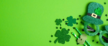 St Patrick's Day Banner Design.Top View Party Glasses, Drinking Straws And Shamrock Leaf Clovers On Green Background With Copy Space. Happy Saint Patricks Day Concept
