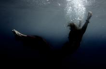 Full Length Of Young Woman Undersea