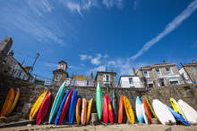 Colorful Canoes Against Sky At Beach