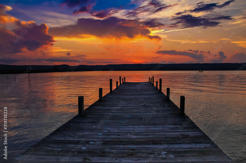 Fototapeta wooden pier at sunset