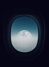Moon Seen Through Airplane Window