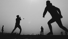 Silhouette People Playing Cricket Against Clear Sky