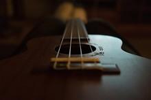 Close-Up Of Guitar In Darkroom