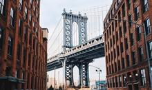Manhattan Bridge By Buildings In City