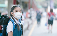 School Girl Wearing Mouth Mask...