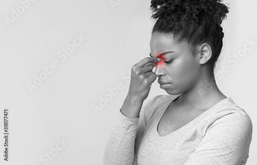 Exhausted afro girl rubbing her nose bridge Wallpaper Mural