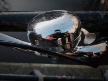 Man Reflecting On Bicycle Bell