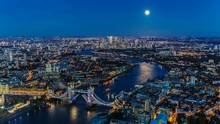High Angle View Of Tower Bridge Over Thames River Amidst Cityscape At Night