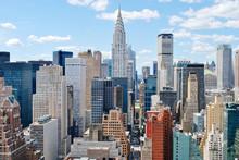 Chrysler Building Amidst Cityscape Against Sky