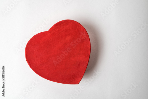 Fototapeta Red heart shaped box on the white background. Directly above. Gift for Valentine's day obraz