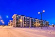 canvas print picture - Winter snowy evening Typical architecture of village suburb Moscow region, Russia. Small modern colorful city in winter snowy evening. Four-storey multi-panel apartment house.