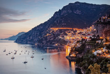 High Angle View Of Sea By Illuminated Buildings At Positano