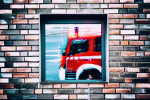 Reflection Of Fire Engine On House Window
