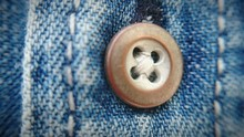 Close-Up Of Button Blue Jeans