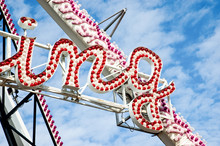 Low Angle View Of Neon Sign At Amusement Park