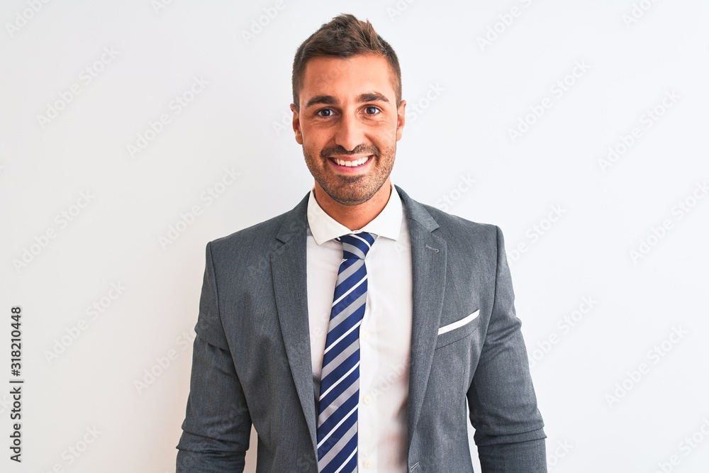 Fototapeta Young handsome business man wearing suit and tie over isolated background with a happy and cool smile on face. Lucky person.