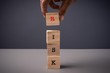 RISK wordings on wooden cubes stacked against grey background