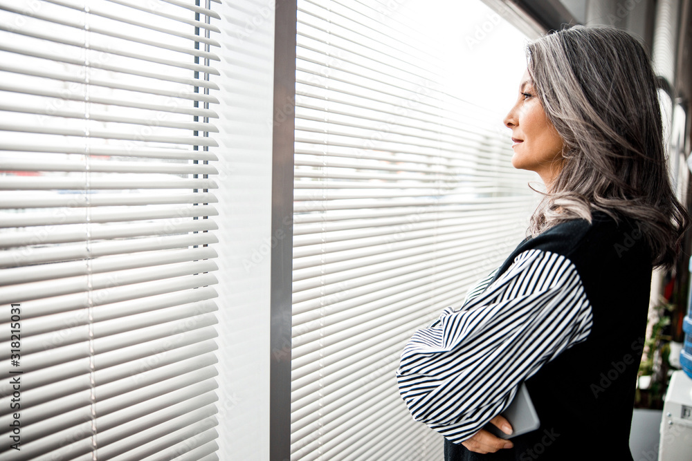 Fototapeta Calm woman in front of the window stock photo