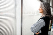 Calm woman in front of the window stock photo