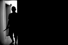 Silhouette Killer Walking In Darkroom At Home