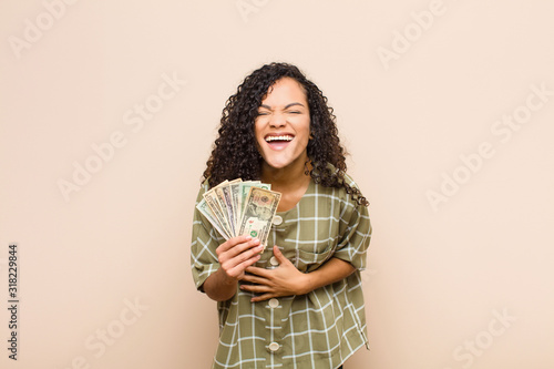 Photo young black woman laughing out loud at some hilarious joke, feeling happy and ch