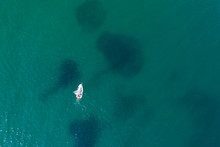 Drone View Of Lonely Boat On T...