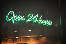 Open 24 Hours Green Neon Sign Illuminated At Night