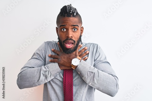 African american businessman with braids wearing tie standing over isolated white background shouting and suffocate because painful strangle Canvas Print