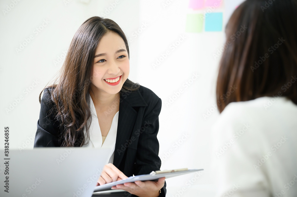 Fototapeta Job interview, We are hiring, Human resource and recruitment concept. Beautiful young asian businesswoman talking applicant people